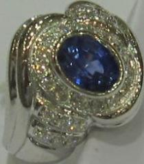 Ring in diamonds and saphir